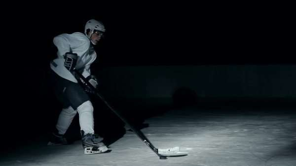 Side view of forward hockey player successfully attacking gates in slow motion Royalty-free stock video