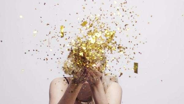 Beautiful Woman Blowing Gold Glitter Confetti Slow Motion