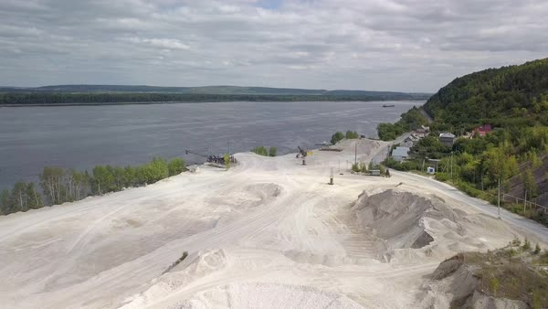 Area of limestone mining on sunny day, near river Volga D2055_6_018