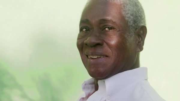 c961d2f9c Black people smiling, portrait of old african american man looking at  camera and laughing stock footage