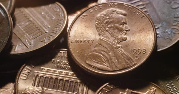 Extreme close-up on a copper Lincoln penny from 1993  stock footage