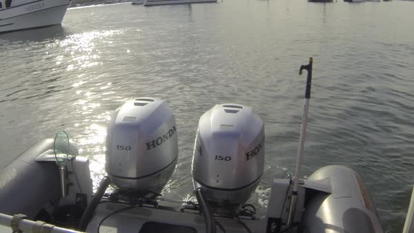 Close-up of Honda outboard motors on stern of boat in the water  stock  footage