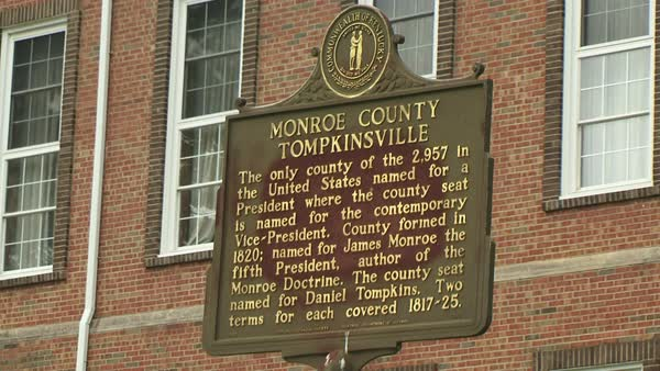 Monroe County signage and informational placque, outside the Monroe County  Courthouse Tompkinsville, Kentucky  stock footage