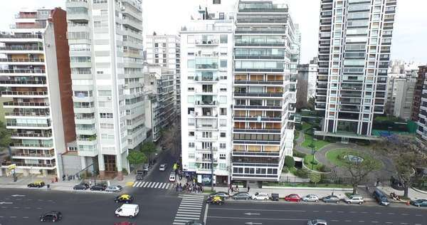 Aerial view of busy road with traffic, camera moves from ground to skyline  in Buenos Aires, Argentina stock footage