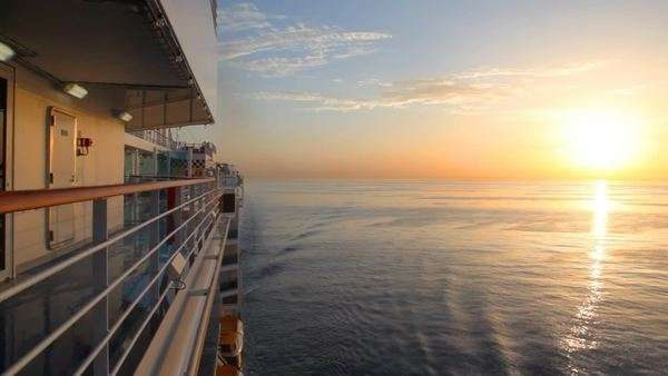 sunrise on sea, view from deck of moving cruise ship Royalty-free stock video