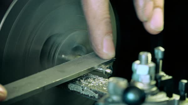 Craftsman polishing piece of metal Royalty-free stock video