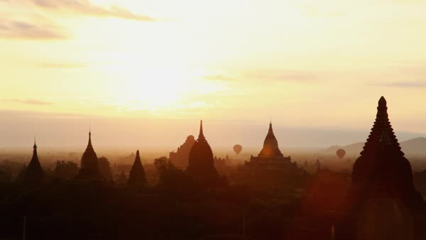 Wide shot of Silhouettes of Bagan temples at sunrise Royalty-free stock video