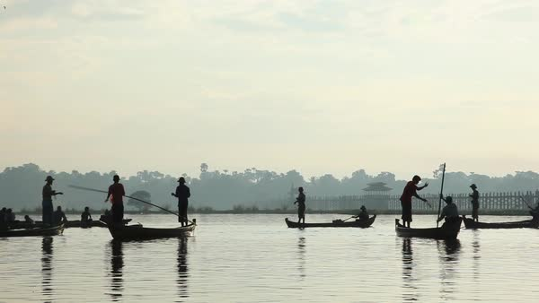 Wide shot of men in canoes on Irrawaddy or Ayeyarwady river Royalty-free stock video