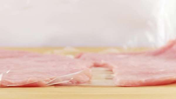 Clingfilm being removed from a tenderised slice of veal Royalty-free stock video