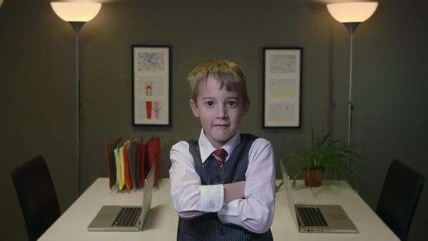 Male Business kid facing the camera and crossing his arms Royalty-free stock video