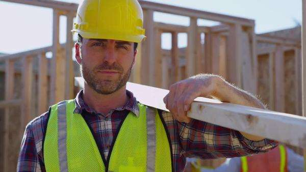 Portrait of construction worker holding board Royalty-free stock video