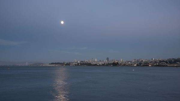 Full moon rising over San Francisco city skyline timelapse at night Royalty-free stock video