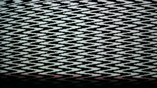 Black And White Pattern Flickering On A Broken Television Screen
