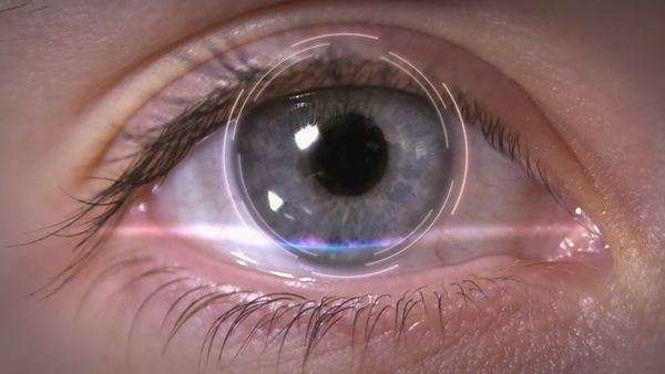 Conceptual representation of a blue eye being scanned for security purposes. Individual variations in the pattern of the iris of the eye make them a popular subject for identity verification. Rights-managed stock video