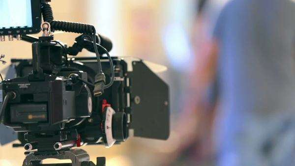 Close up of camera on film set waiting for scene preparation. Blurred background. Royalty-free stock video