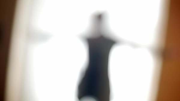 Hand-held abstract shot of a person spreading arms Royalty-free stock video