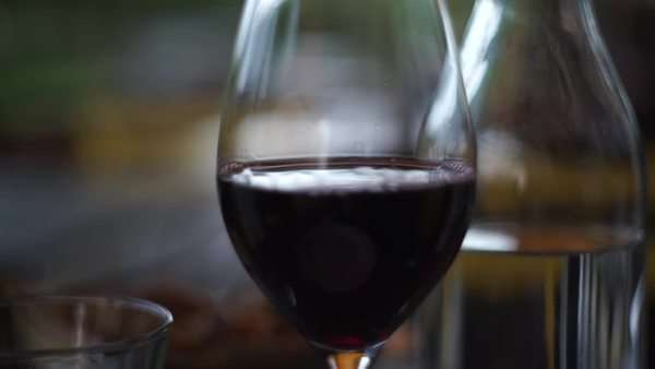 Close-up shot of a table in a restaurant with a glass of wine Royalty-free stock video