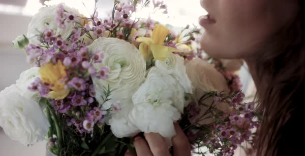 Close-up shot of a woman smelling a bunch of flowers Royalty-free stock video