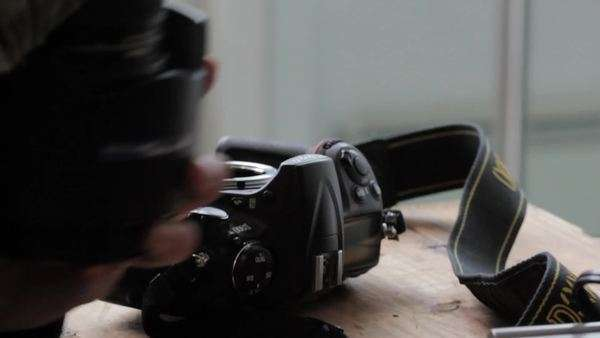 Handheld shot showing the process of changing the lenses of a camera Royalty-free stock video