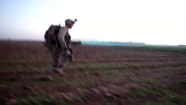 U S  Army foot patrols move through Afghanistan during the Afghan War and  engage in combat operations  stock footage