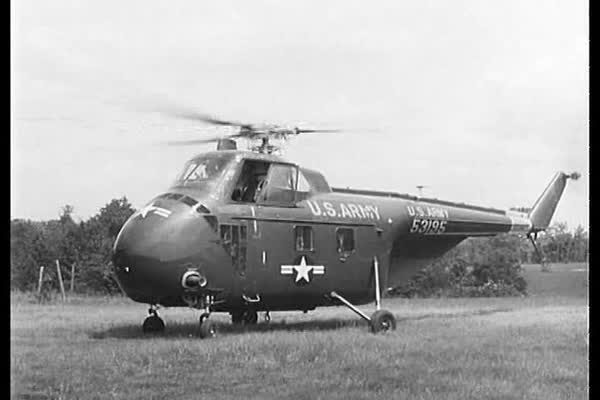 A pilot takes off from the ground in the h-19 helicopter at the Fort Rucker Aviation Centre in the 1950s. Royalty-free stock video