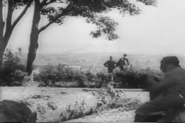 Combat footage from the ground shows Allied bombs dropping relentlessly on  Nazi strongholds in France