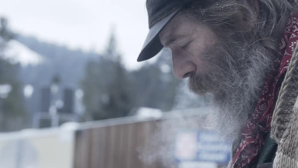 Slow motion of a man exhaling smoke Royalty-free stock video