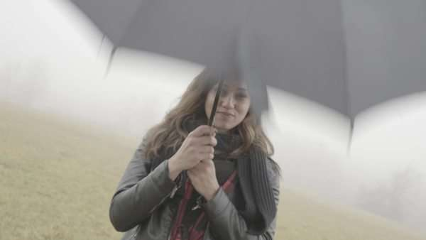 Medium shot of woman playing with an umbrella Royalty-free stock video