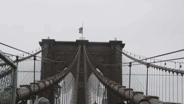 Medium shot of people walking on the Brooklyn bridge in New York City, USA Royalty-free stock video