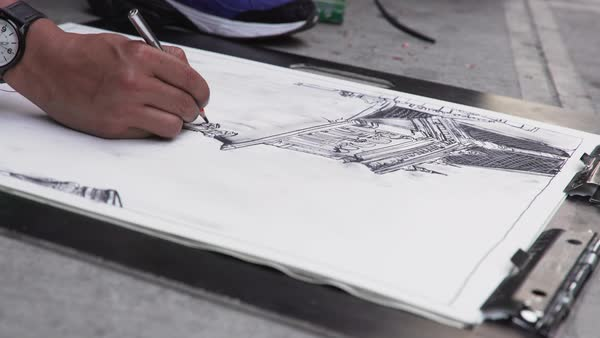 Close-up shot of an artist drawing on a clipboard Royalty-free stock video