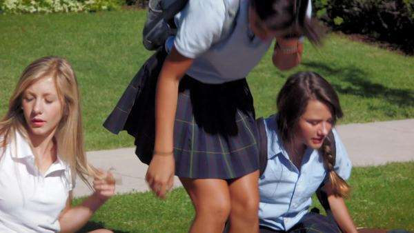 Three Pretty Uniformed Teen School Girls Sitting Chatting One Eats An Apple Stock Video Footage Dissolve