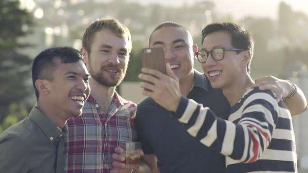 Happy gay couples take a selfie together, then they enjoy looking at the photo Royalty-free stock video