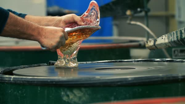 Blowing glass - grinding a glass piece Royalty-free stock video