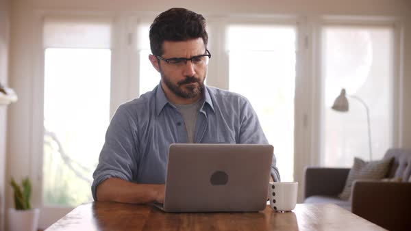 Man working from home using laptop on dining table Royalty-free stock video