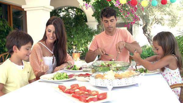 Hispanic family eating meal at home together Royalty-free stock video
