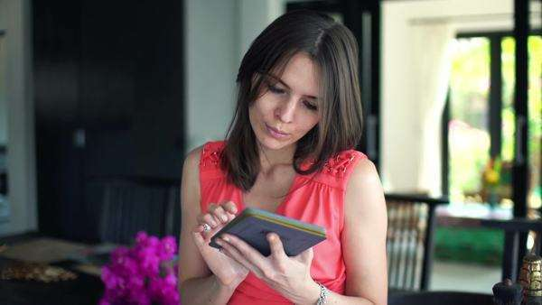 Young woman reading book on eBook reader at home Royalty-free stock video