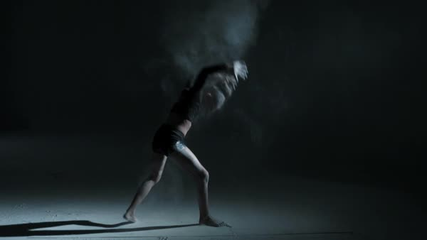 Silhouette of freestyle dancing young girl using powder in dance moves Royalty-free stock video