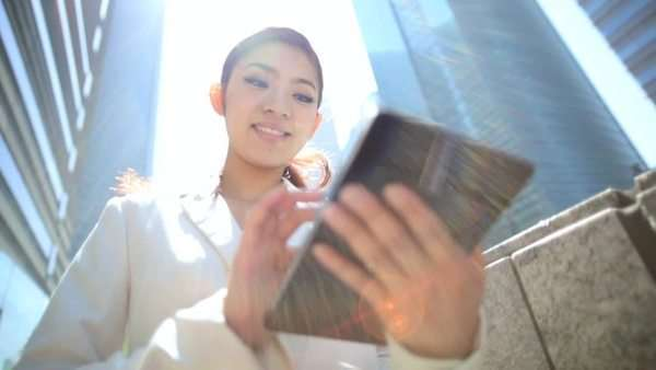 Young Ethnic Asian Japanese Businesswoman City Downtown Tablet Device Royalty-free stock video