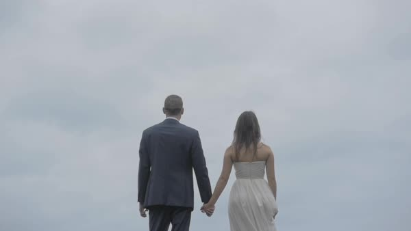 Back view of a bride and a groom holding hands Royalty-free stock video