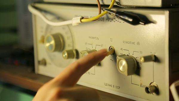 Low-frequency signal generator, a scientist controls, close-up stock footage