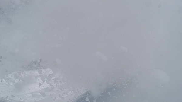 SLOW MOTION: Happy snowboarder having fun snowboarding backcountry on a sunny winter day in snowy mountains Royalty-free stock video