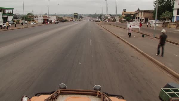 Wide shot of a car on an African road Rights-managed stock video