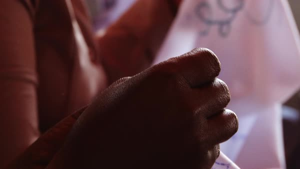 Close-up shot of women embroidering in Africa Rights-managed stock video