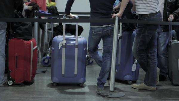 Medium shot of people queuing in an airport Royalty-free stock video
