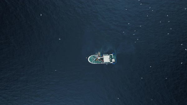 Zoom out of a commercial ship fishing with trawl net on the sea. Top down view. Royalty-free stock video