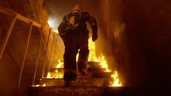 Fireman runs up the burning stairs Royalty-free stock video