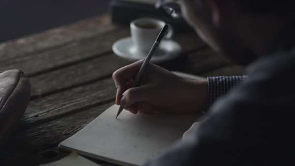 Designer is sketching ui design in notebook at evening. Royalty-free stock video