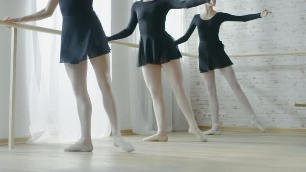Close-up shot of ballerina's legs doing stretches in the morning Royalty-free stock video