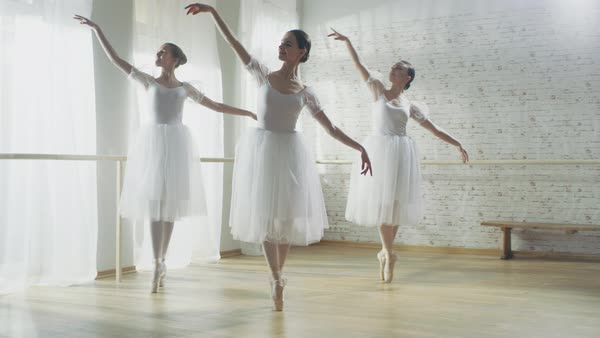 Three young and  ballerinas dancing in sync Royalty-free stock video