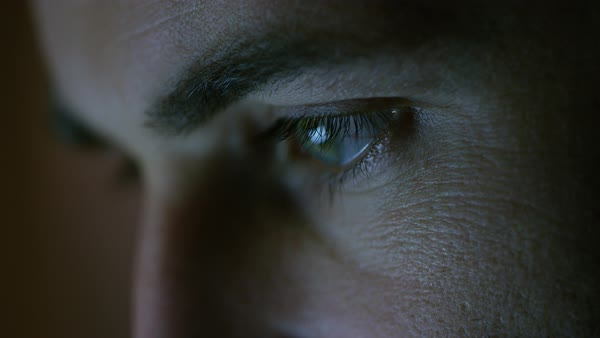 Close-up of a green-blue man's eyes with screen reflecting in them Royalty-free stock video